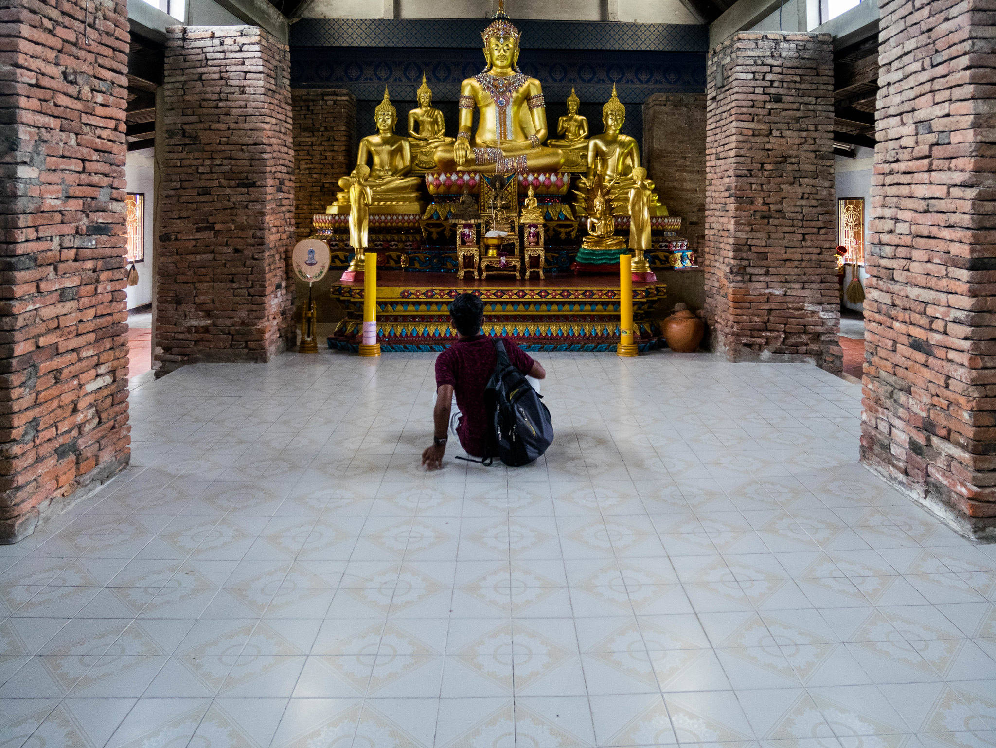 Man in front of Buddha