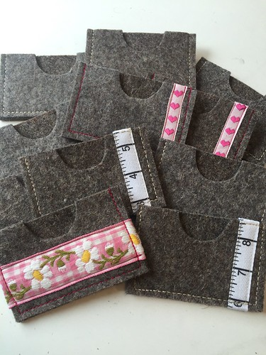 Wool card wallets by Poppyprint. Used off its of expensive industrial wool to make these.