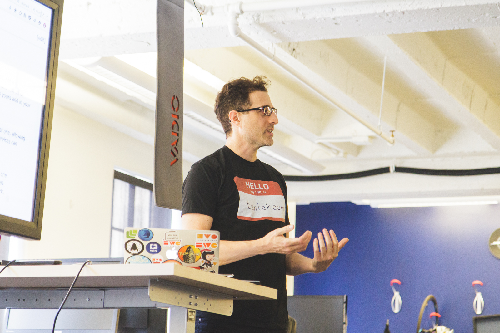 Photo of Tantek speaking at IndieWeb Summit 2016