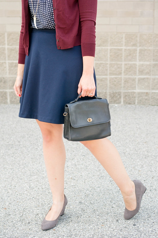 navy and white polka dot blouse + maroon cardigan + navy skirt + gray suede wedge heels; fall work outfit | Style On Target blog