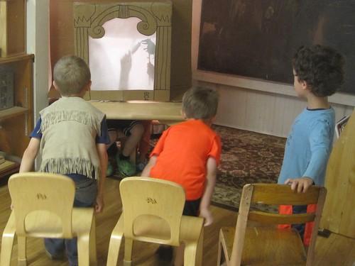 enjoying a puppet show