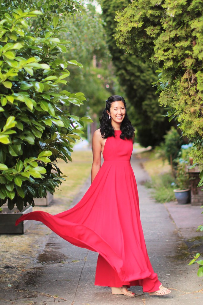wedding guest outfit ideas: red maxi dress styled with vintage-inspired jewelry