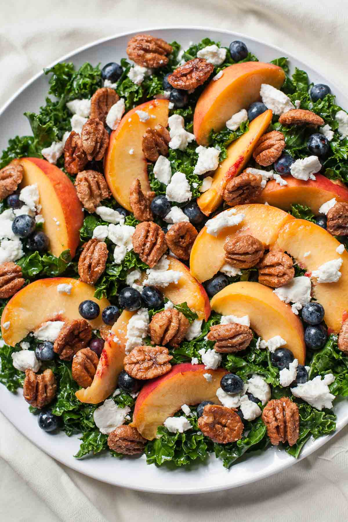 Summer Kale Salad with Peaches and Candied Pecans