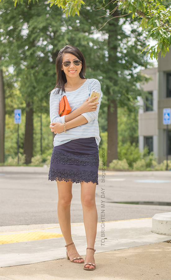 light blue striped top, navy lace mini skirt, orange clutch, brown jeweled sandals