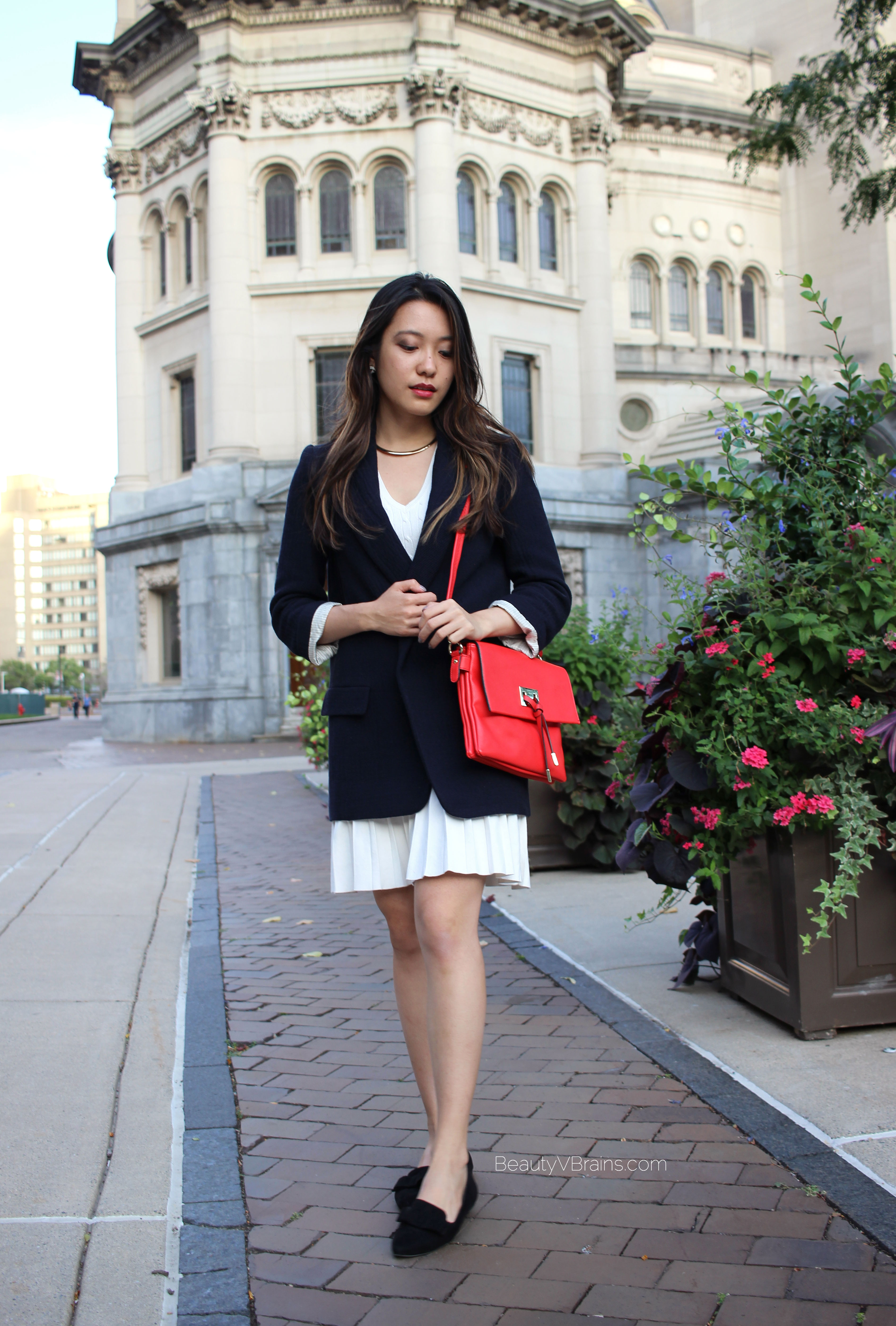 Oversized blazer, white pleated skirt, black flats outfit