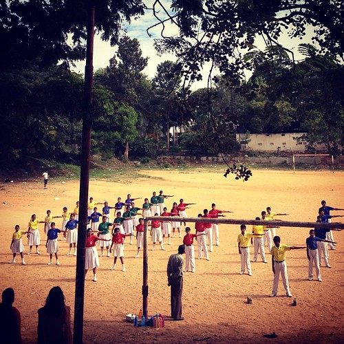 Rainbow students exercises #morning #sunny #colours #yellow #blue #red #students #postures #exercices #field #india #bangalore #igindia | by Scalino