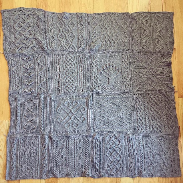 Aran afghan squares sewn together. It looks a little lopsided but a knit-on cable border (and blocking) will help. #knitting #greatamericanaranafghan