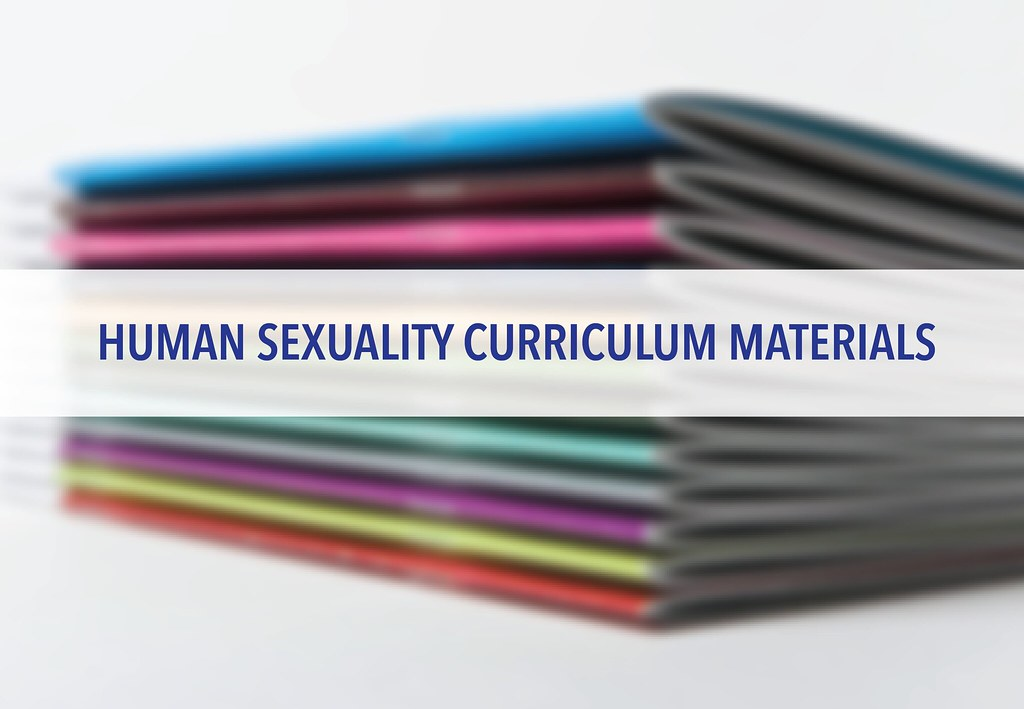 Stack of booklets with overlay text 'Human Sexuality Curriculum Materials'
