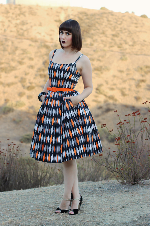 Pinup Girl Clothing Pinup Couture Jenny Dress in Halloween Harlequin Print