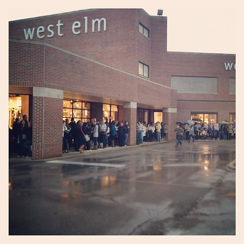 The line is wrapped around the store for @younghouselove , even in the rain. | by Nicole Balch