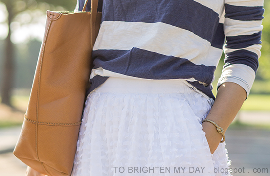 wide navy striped top, white midi skirt with clip dot, cognac brown tote