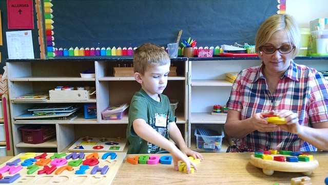 Benji and Mrs. M play letters