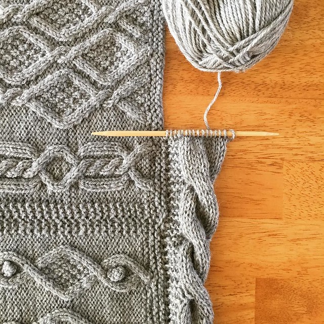Slowly but surely, the cabled border is making its way around the afghan. #knitting #greatamericanaranafghan