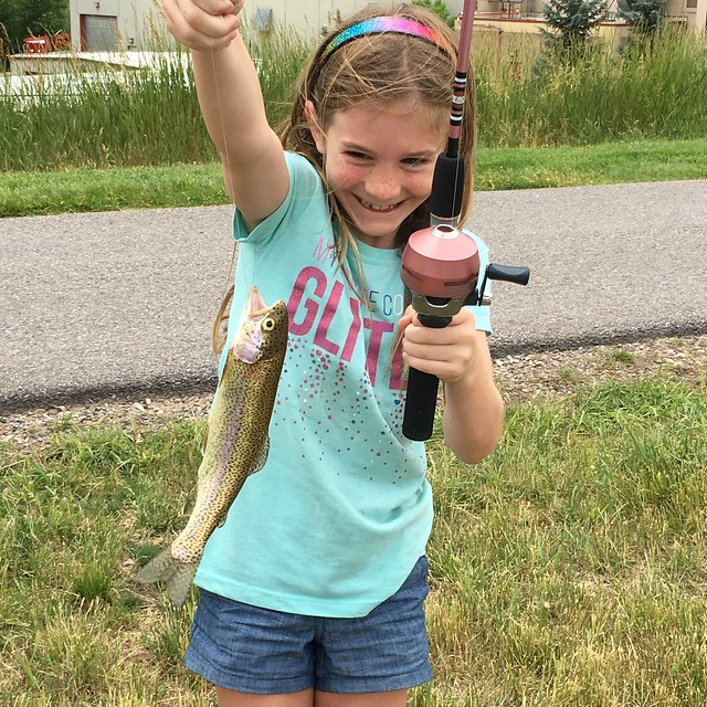 Lizzy catches her own rainbow trout.