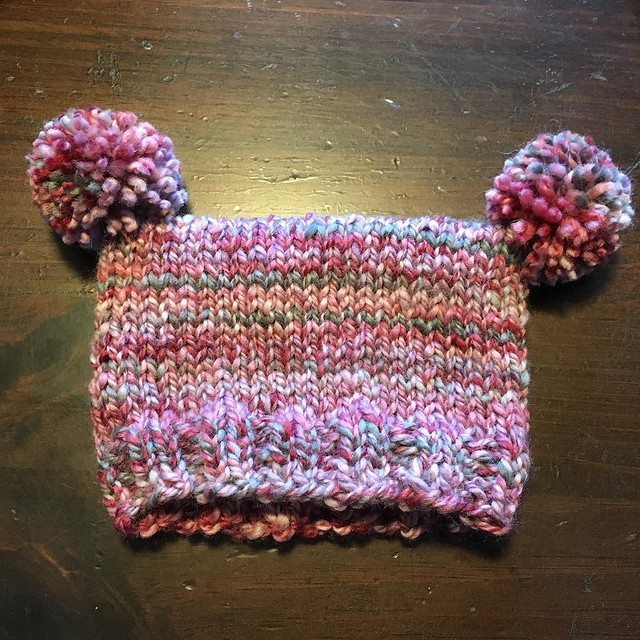 D'awww. Finished the hat last night, made the pompoms this morning. Yarn is handspun I made doing a spinning demonstration at the Tunbridge Fair two years ago. #knitting #handspun #babyknitting