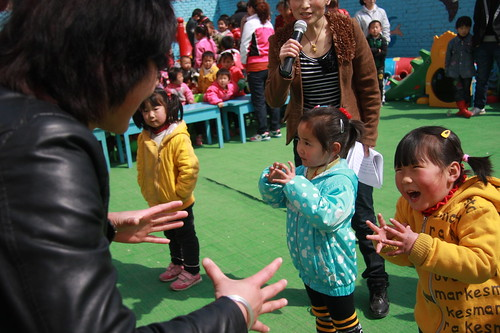 Preschool children playing interactive game with parents | by Plan Asia