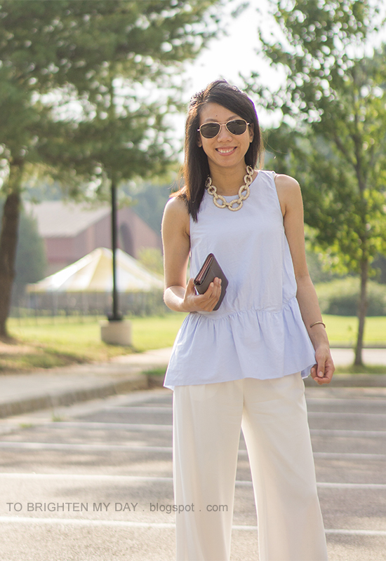 gold pave link necklace, baby blue peplum top, white wide-legged trousers, taupe clutch