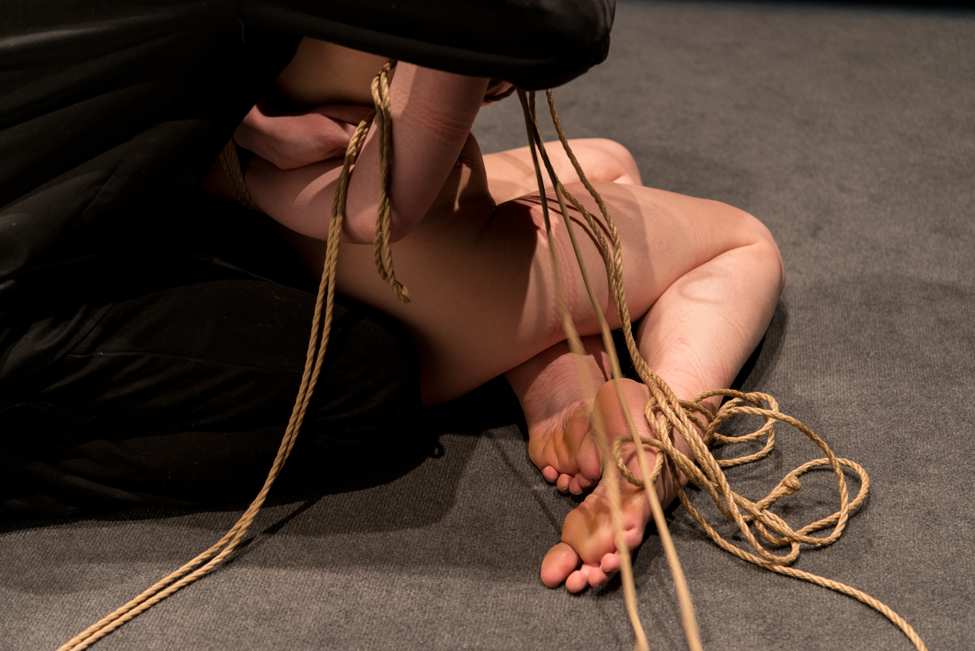 Rope details as Pedro unties Gestalta at the end of a shibari performance