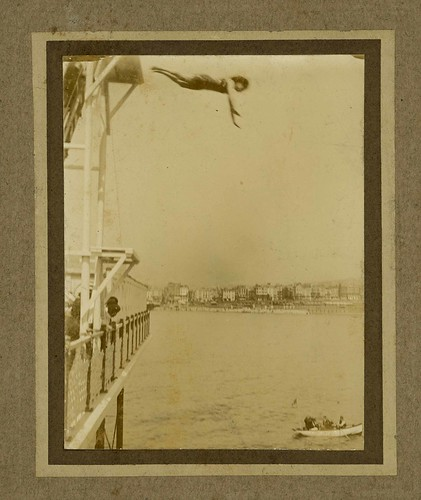 Photograph of Beatrice Kerr diving from a platform