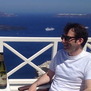 Me, smiling in the sun at Santo Wines on Santorini. | by jamesonf