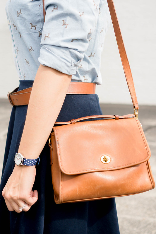 dog print shirt + madewell cognac belt + polka dot watch + navy skirt + court coach purse | Style On Target