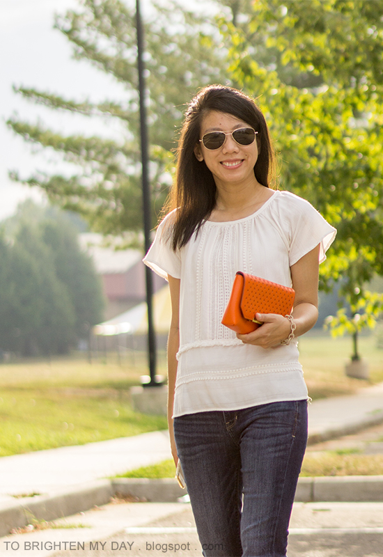 fringe and lace boho top, orange clutch, bootcut jeans