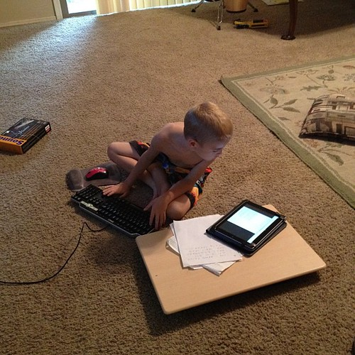 This is my eight year old son, using the iPad to look up decimal and hexadecimal information so he can hack for resources.  Like father, like son. | by Faceless Librarian