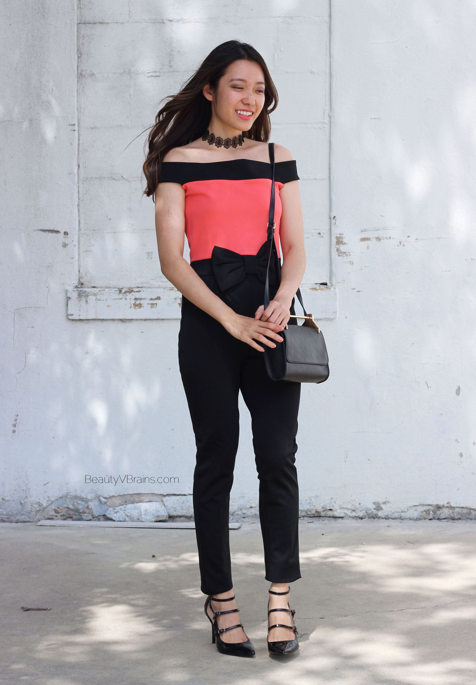 Strapless coral and black bow waist jumpsuit