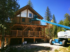 The siding is almost finished on The House! Dad rented a high lift and finished 80% today. This is the before photo.
