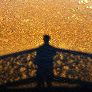 shadow self-portrait with river bed