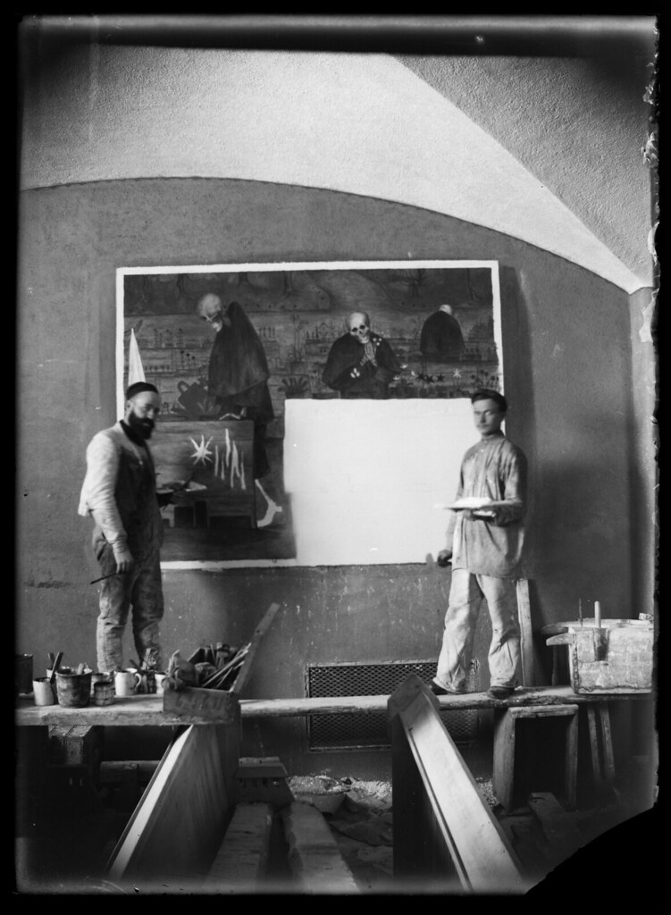 Hugo Simberg on the left, painting Garden of Death, 1906