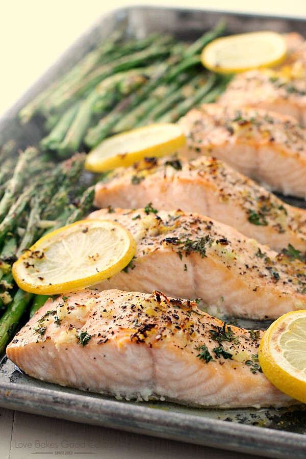 Dinner is quick, healthy, and easy with this Sheet Pan Lemon, Garlic & Herb Salmon with Asparagus recipe! It's a family-favorite!