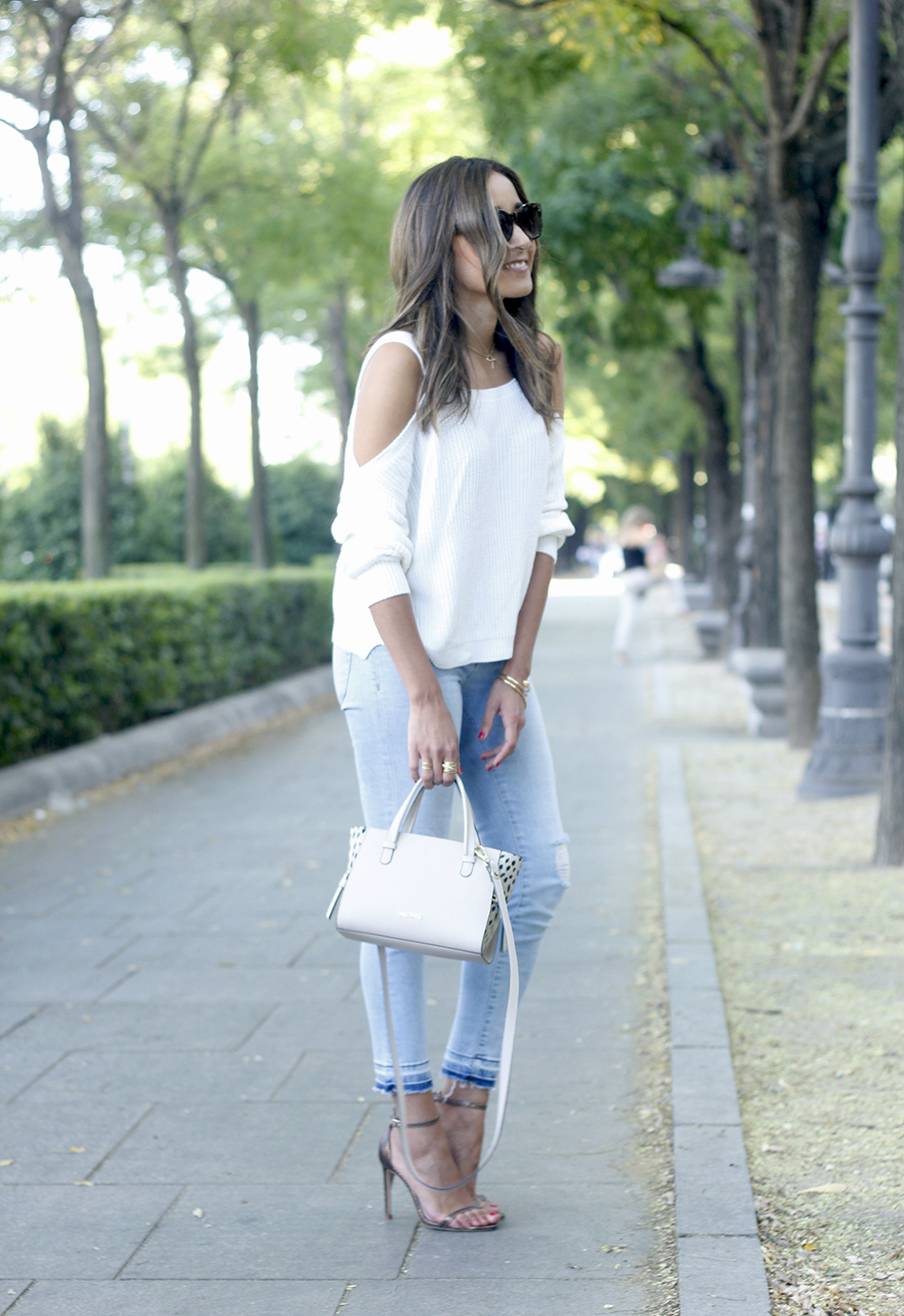 White off the shoulder sweater jeans acosta bag heels outfit style02