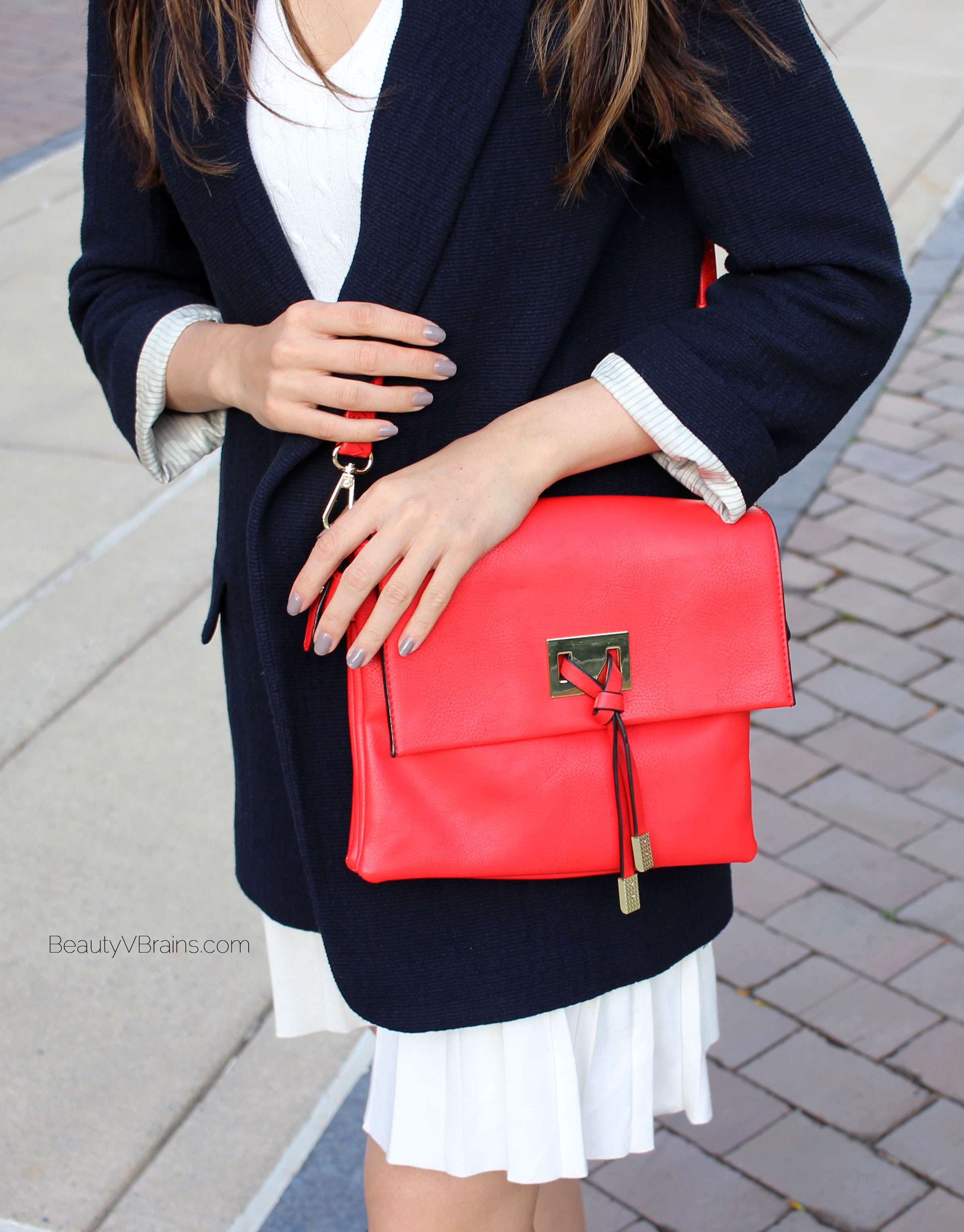 Red flap bag and Miss Fancy Pants nail polish