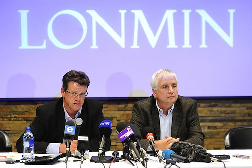 Mark Munroe (L), executive vice president for mining at Lonmin, the world's third-largest platinum mining company, speaks alongside Lonmin chief financial officer Simon Scott during a press conference on August 20, 2012, in Marikana. | by Pan-African News Wire File Photos