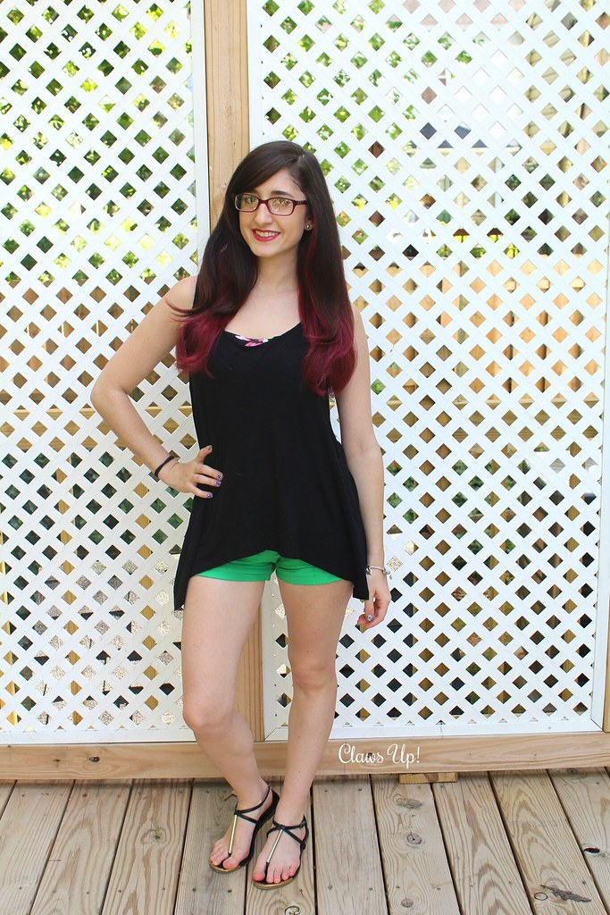 Split back tank top, green shorts, and wine colored hair