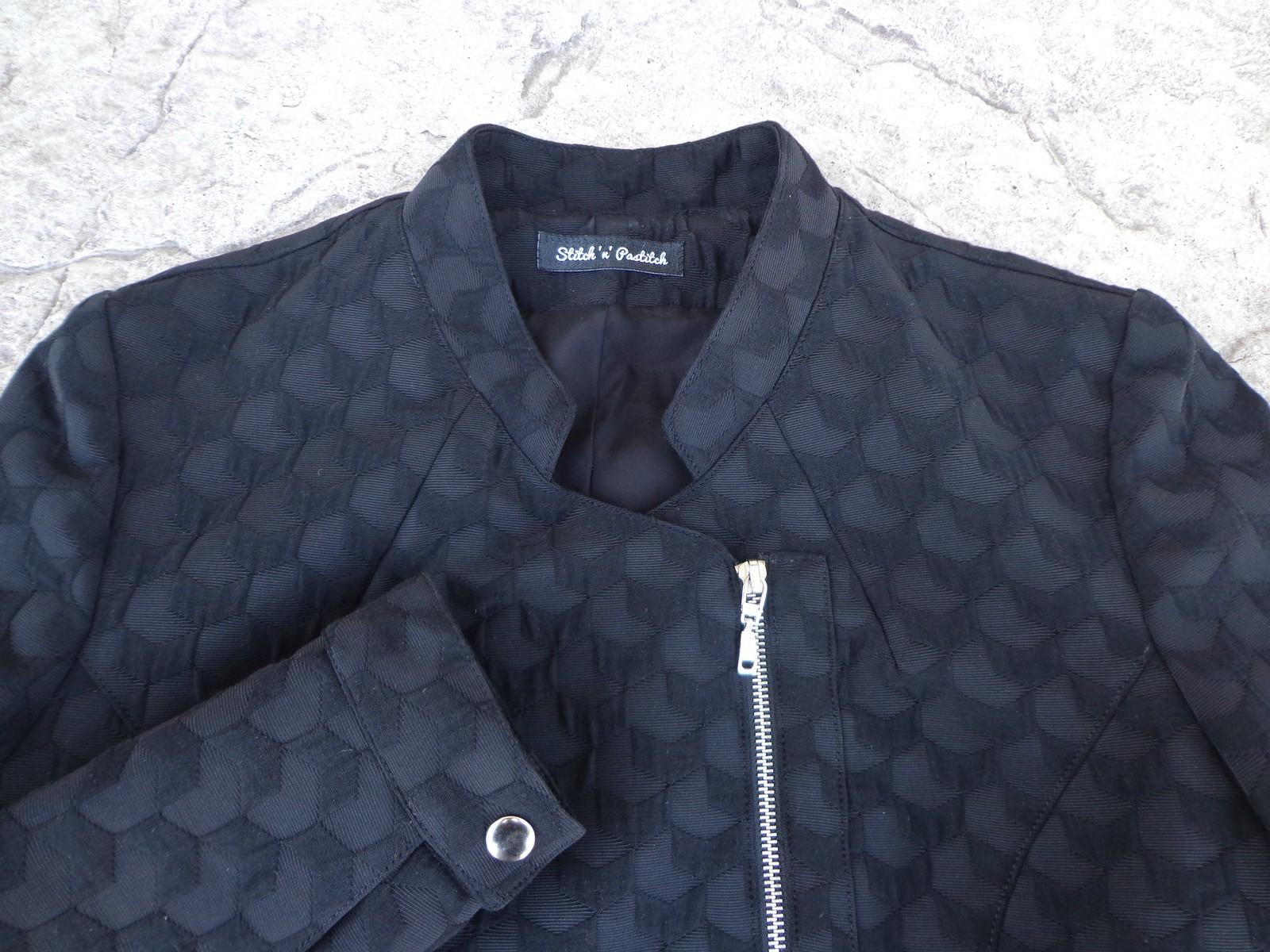 Dettagli giacca asimmetrica Burda