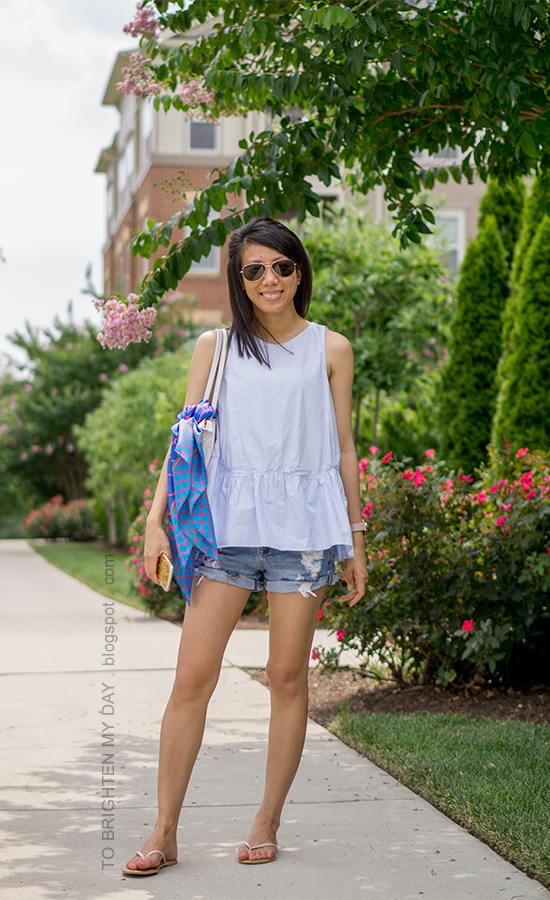 baby blue peplum top, oversized watch, distressed shorts, flip flops, blue chain scarf on white tote bag
