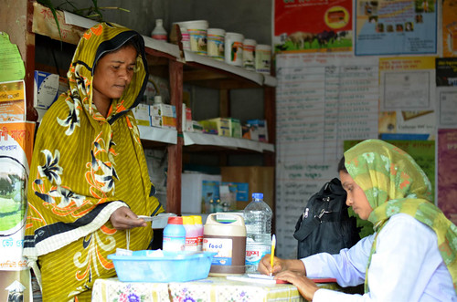 A livestock health worker prescribes drugs to a dairy farmer in Bangladesh