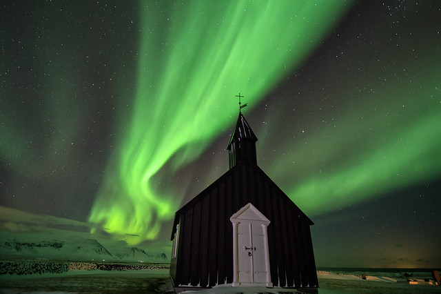 Northern Lights over Black church at Budir, Iceland