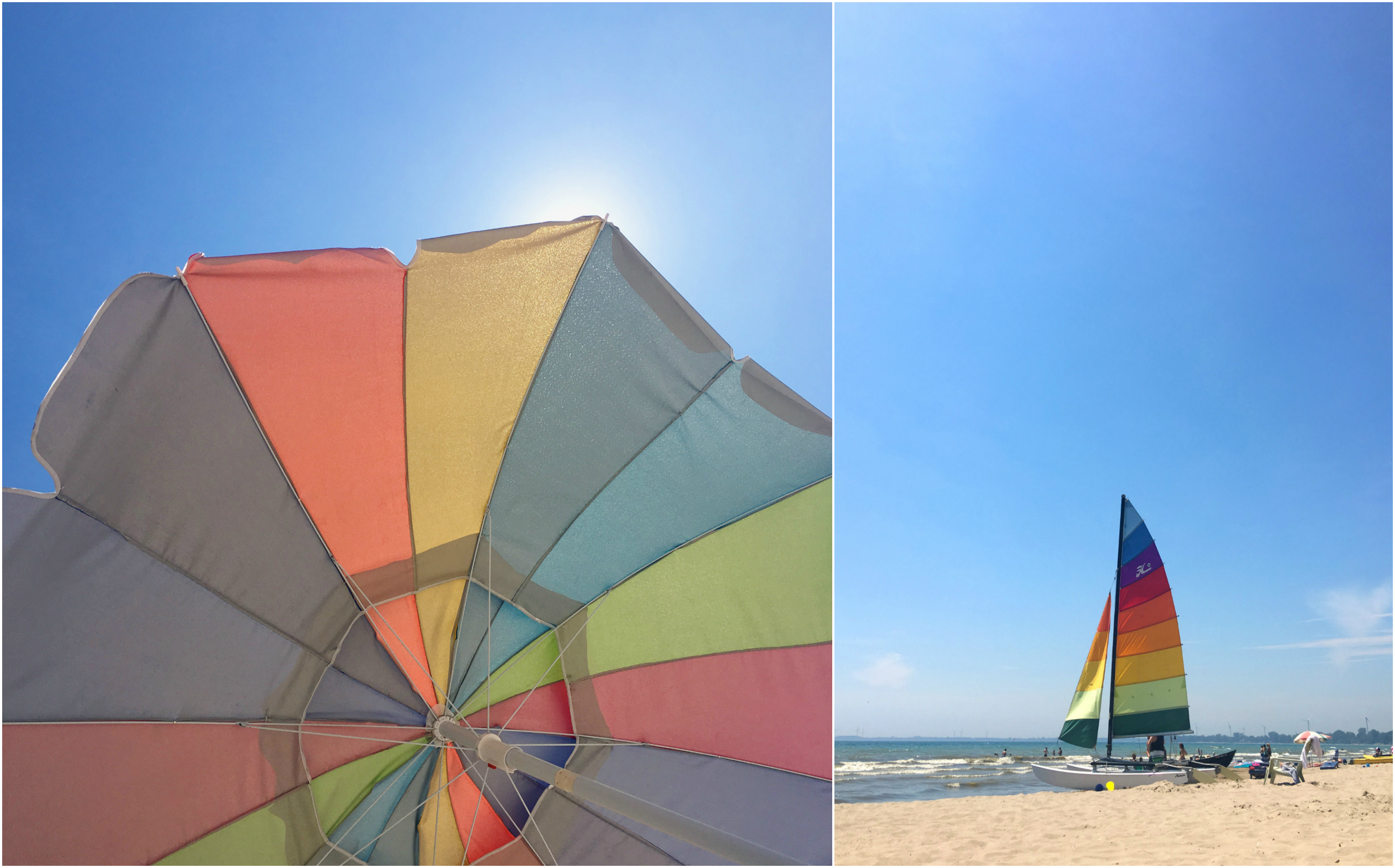 rainbow beach - sailboat and umbrella on the beach