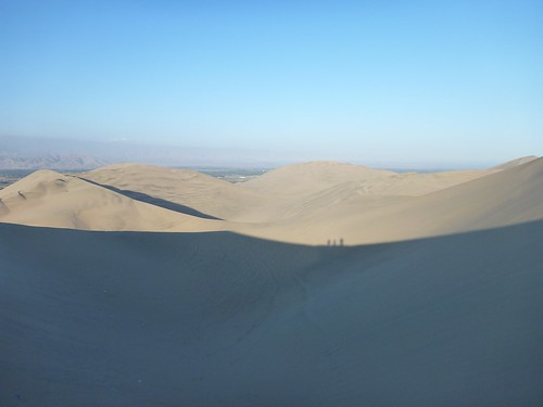 Our shadows against the next dune