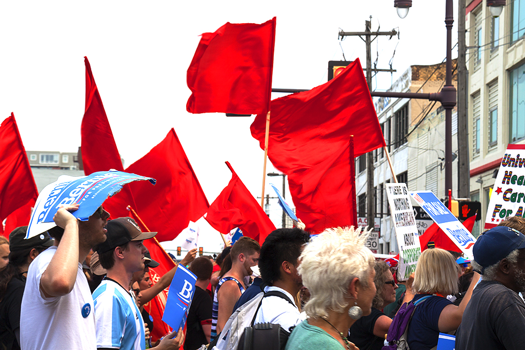 Bernie supporters with red flags--South Broad