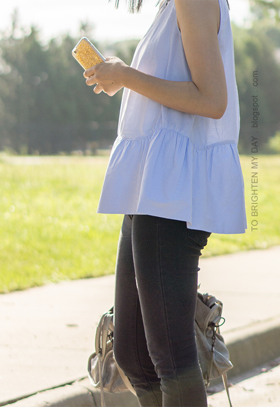 light blue sleeveless peplum top, black jeans
