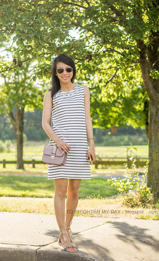 striped shift dress with jewels, gold jewelry, jeweled sandals with tied bow, nude bag