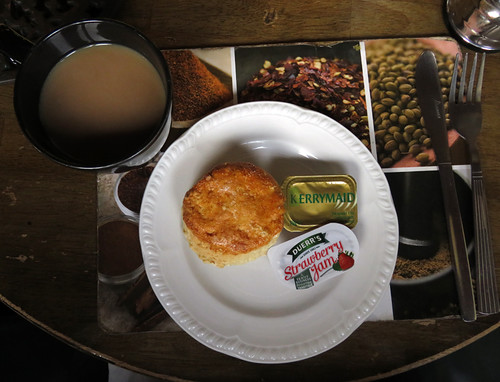 Part 2 of the full Irish breakfast consists of fresh-baked scone, Irish butter, strawberry jam and coffee