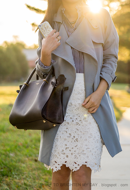 gray draped trench, navy striped top, white floral lace pencil skirt, stacked rings, gray tote