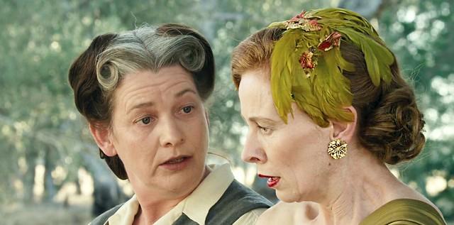 dressmaker.olivegreen.feathers