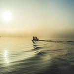 boat under misty ment