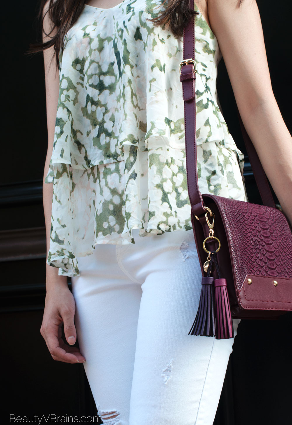 White ripped jeans and purple snakeskin bag